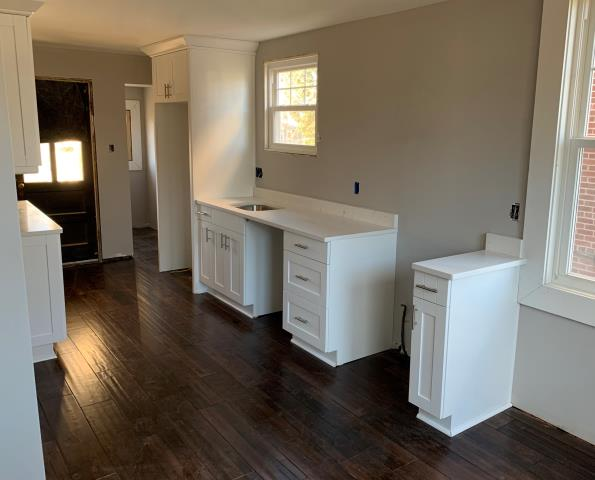 Richmond, VA - Just finished white shaker cabinet installation with our in-stock quartz. It's going to look great when the appliances, hood and floating shelves are installed!