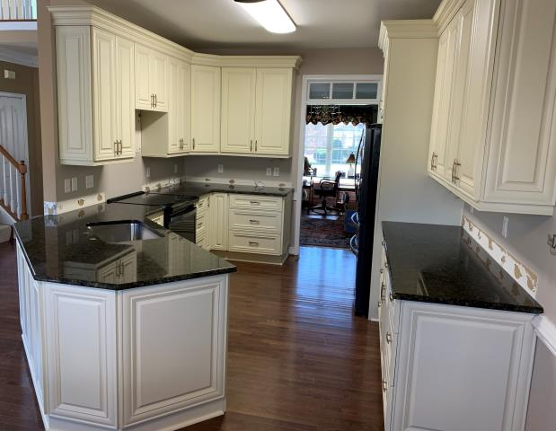 Chesterfield, VA - Just finished installing our vanilla maple wood raised panel cabinets with our in-stock green butterfly granite. We love the new extra hidden storage behind the sink area.