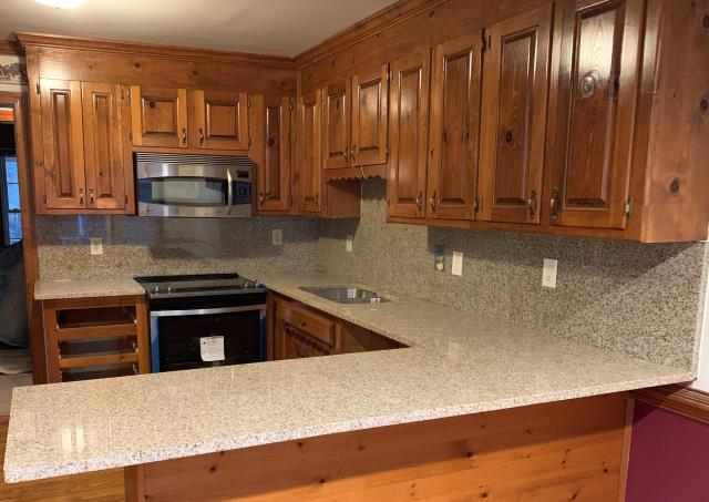 Chesterfield, VA - Wheatfield with full granite splash installed with client's existing cabinets.  After the 25-year sealer warranty application, we will be completely done with this job.