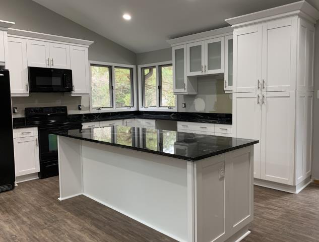Richmond, VA - Look at this gorgeous kitchen.  Our in-stock white shaker maple cabinets with the Paradiso Silver granite counters.  This classic kitchen is stunning.  What a transformation!!