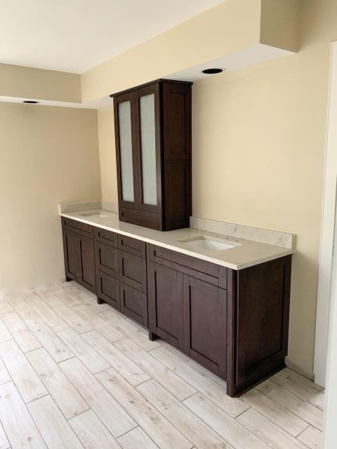 Richmond, VA - This is the third bathroom we have completed for this sweet client.  All three bathrooms with the in-stock chocolate shaker maple cabinets.  The first two vanity counters were installed with the white ice granite and this one we used the ocean white, my favorite quartz counter.