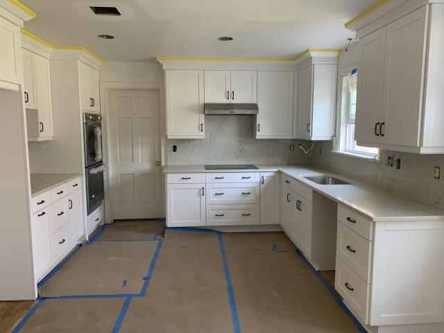 White shaker kitchen cabinets with my favorite quartz in-stock at a very good price with FULL QUARTZ backsplash.  Can wait for everything to be completed.  This kitchen will definitely be one of the most beautiful kitchens we have completed.