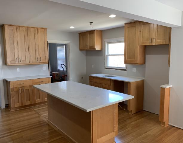 Richmond, VA - Double Shaker maple kitchen cabinets with the white quartz countertop.  This kitchen was completed in 1 1/2 day by our incredible installers.
