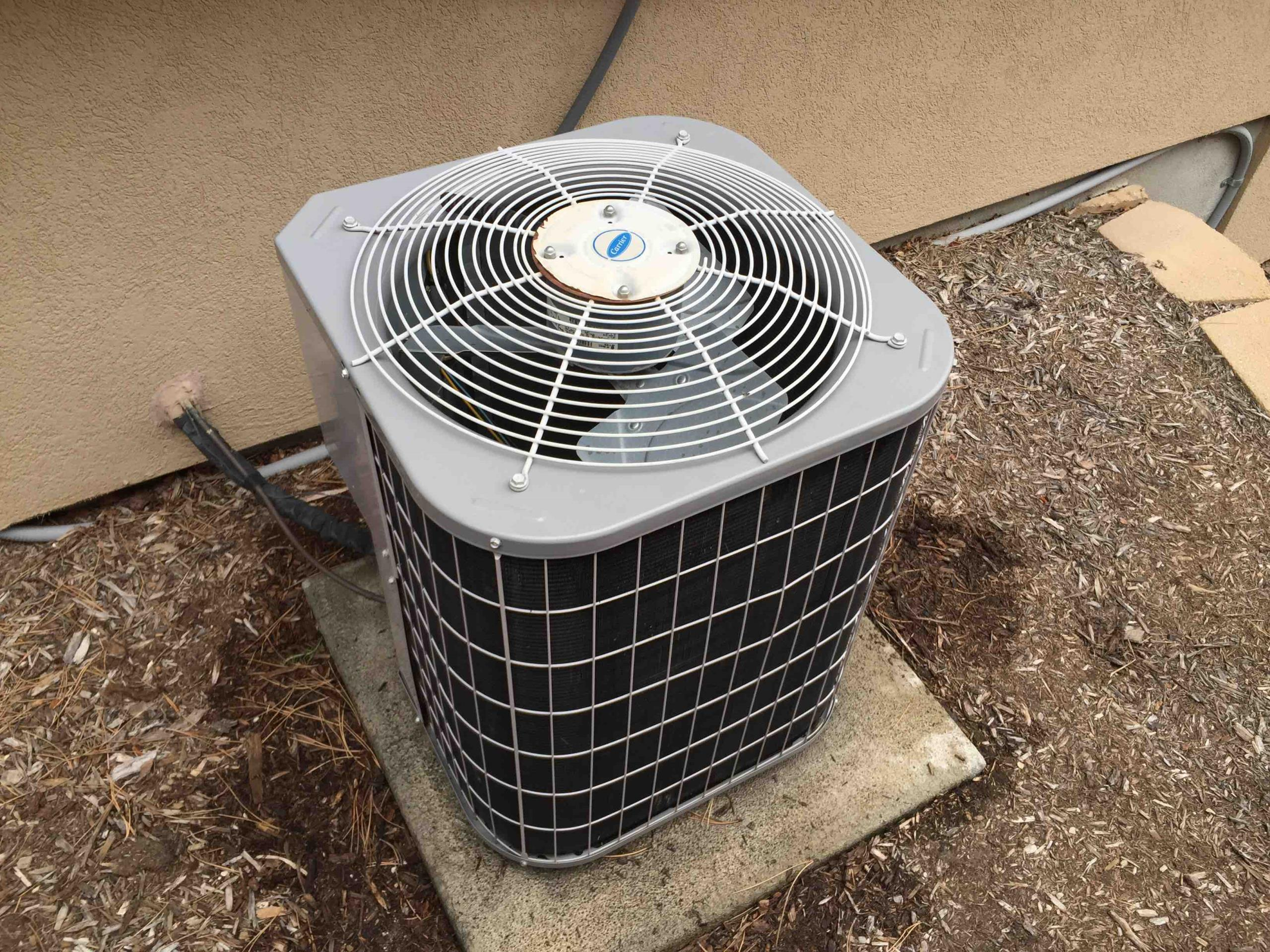 Draper, UT - servicing a Carrier Air Conditioner