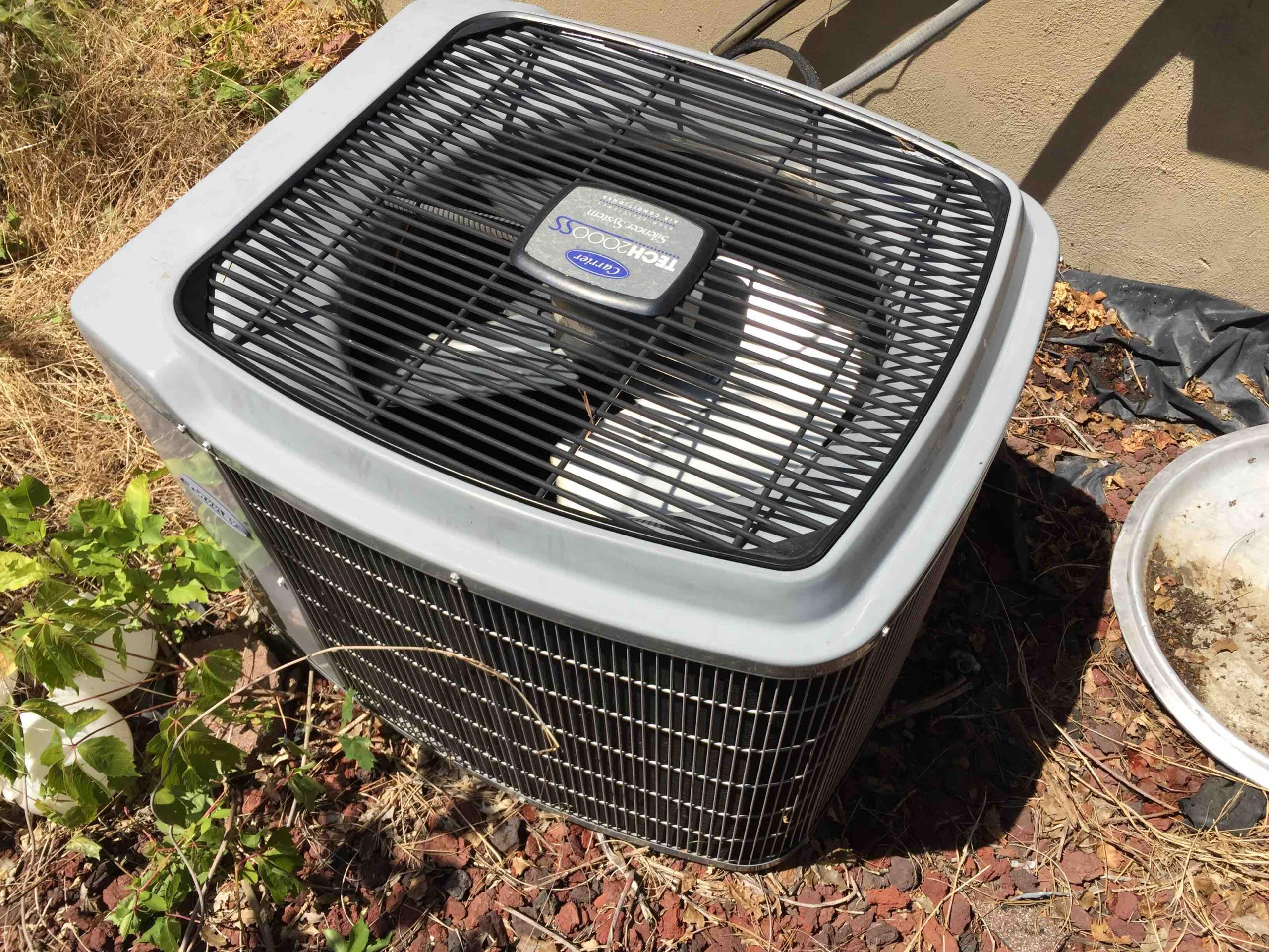 Holladay, UT - servicing a Carrier Air Conditioner