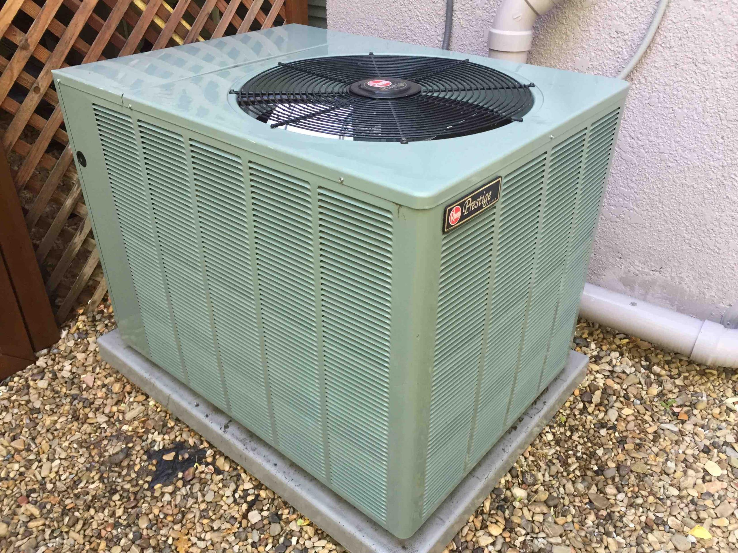 Sandy, UT - servicing a Rheem Pretige air Conditioner