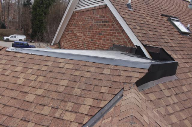 Cary, NC - Repair: removed & replaced the flat roof and all the metal in the area and tie it into the flat roof.