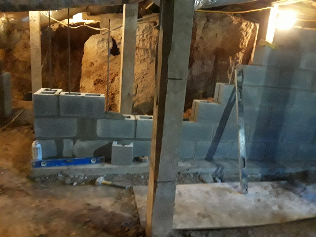Rocky Face, GA - Foundation Specialists working on 900 square feet of block walls in a 200 year old Civil War era home for a family who has owned the property for over 200 years