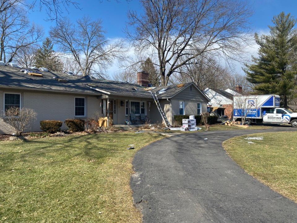 Indianapolis, IN - Supervising a shingle roof install