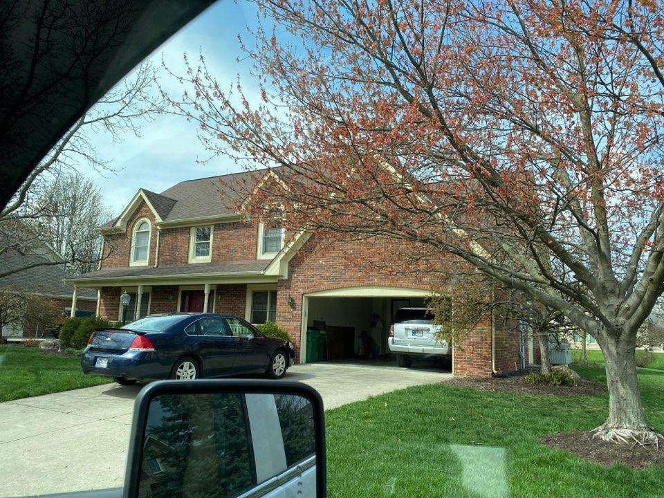 Carmel, IN - Inspecting home for hail damage