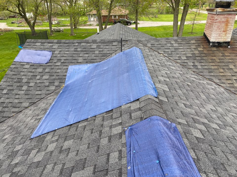 Pittsboro, IN - Inspecting roof for leaks
