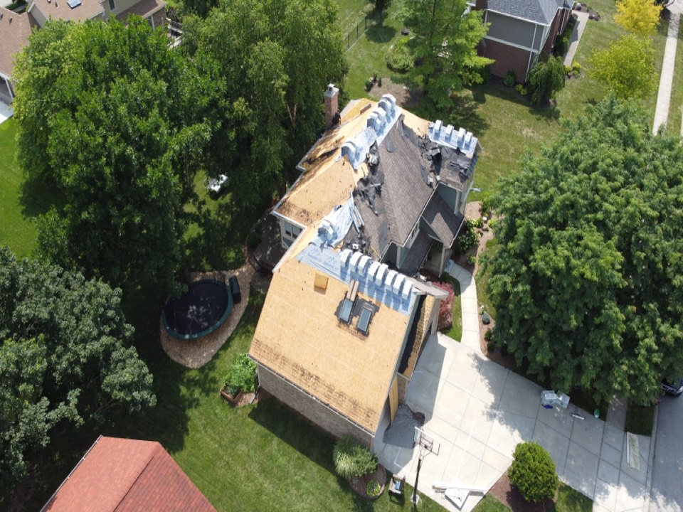 Carmel, IN - Supervising a installation of a roof system. This was an insurance claim due to hail damage. We helped the home owner through the process and will be completing the project later this week.