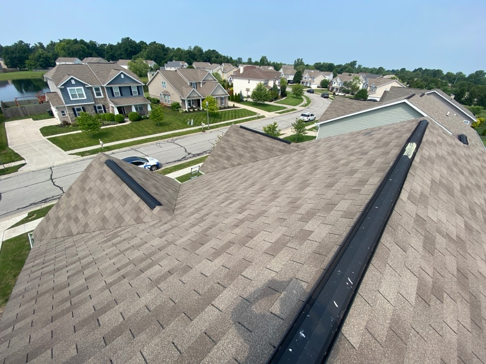McCordsville, IN - Inspecting a home for hail and wind damage. Owner has damage in soft metal and gutters. I did not see enough damage on the roof so I will not recommend for they to make a claim. We will be able to assist repairing the blown shingles.