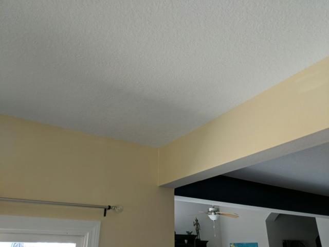 Replaced section of damaged drywall and wood rot.