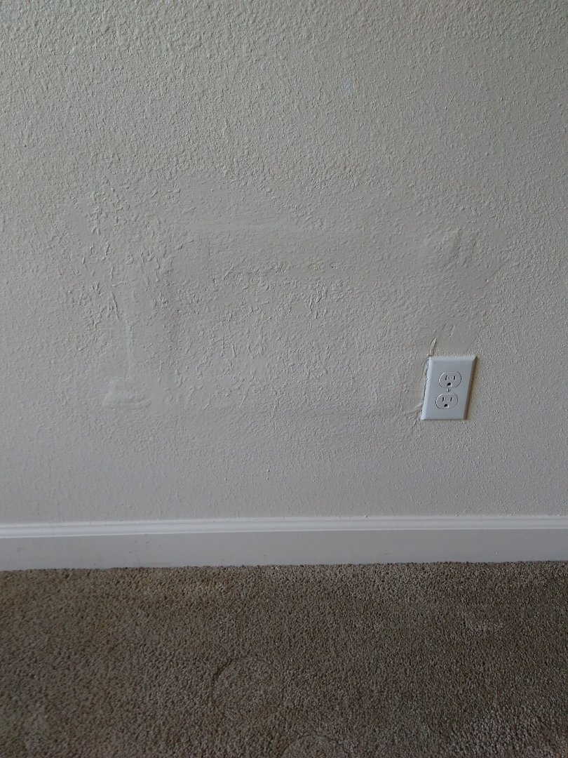 Patched, textured, and painted drywall/sheetrock.
