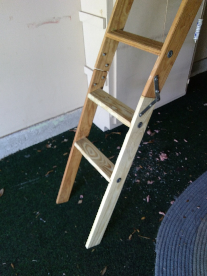 Repaired broken attic access ladder.