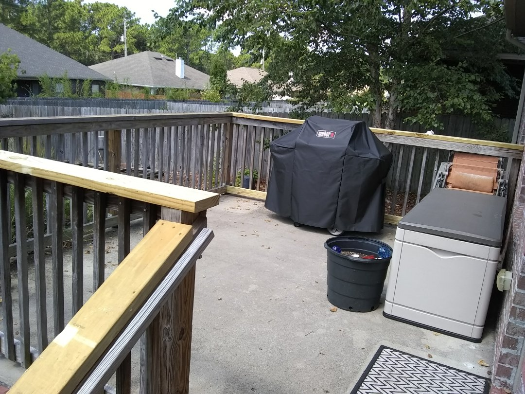 Replaced handrails on back deck. Supported leaning fence with new posts.