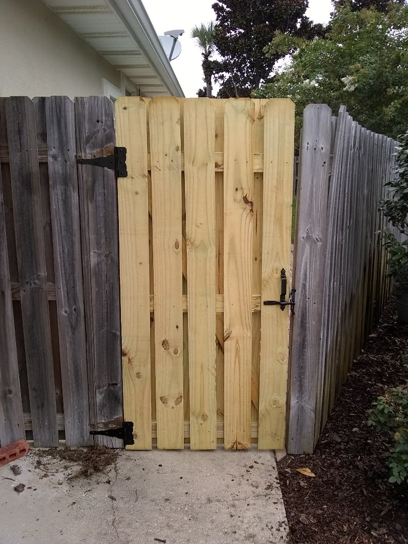 Rebuilt gate for privacy fence. Installed L latch on existing gate. Removed debris from yard.