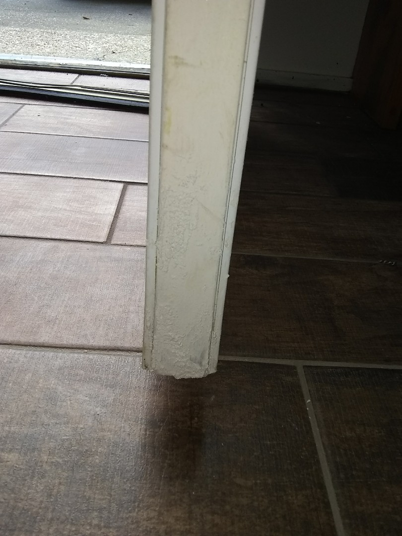 Pensacola, FL - Repaired wood rot on two exterior doors with wood, filler, caulk, and paint.