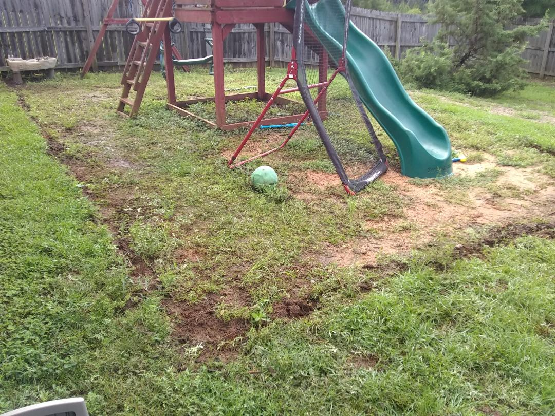 Pace, FL - Removed rotten landscape timbers from around garden and jungle gym.