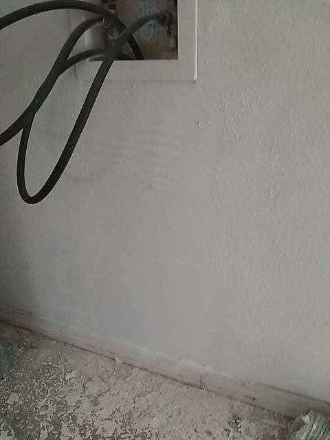 Pace, FL - Repaired sheetrock, repaired baseboards, repaired rotten door jamb and trim.