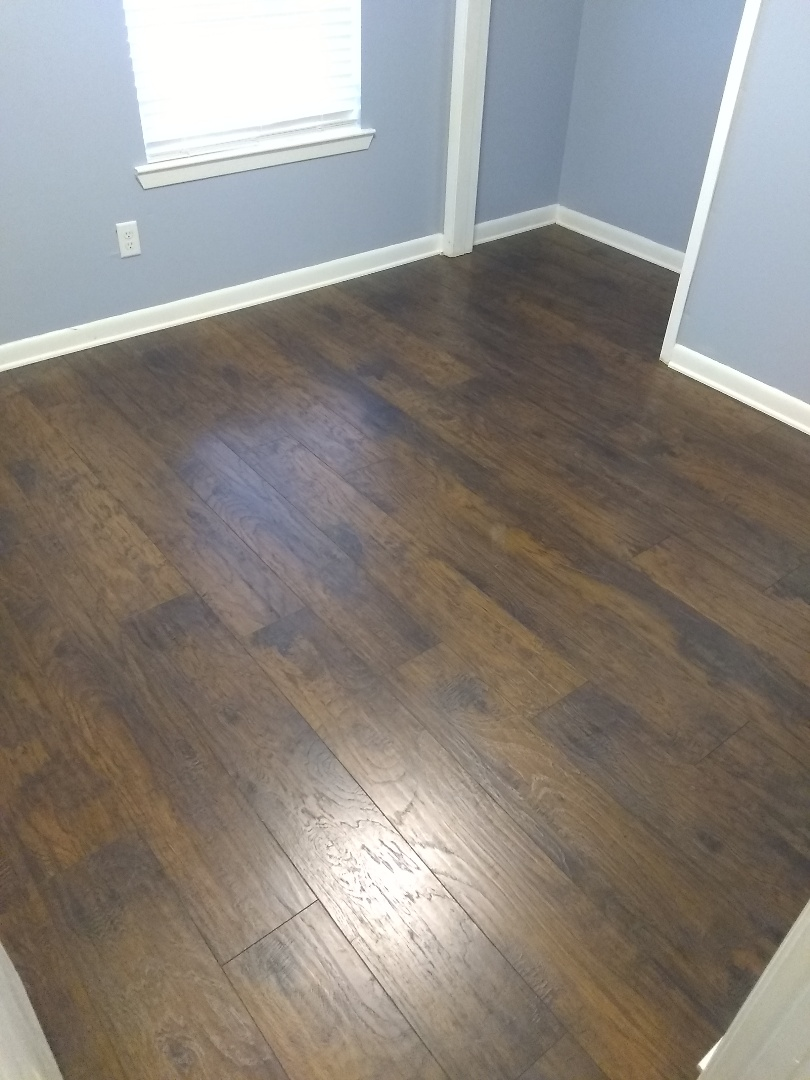 Milton, FL - Installed approx. 110 sqft of flooring and installed two sliding closet doors