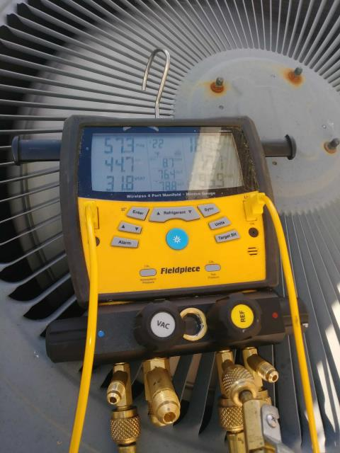 Raleigh, NC - Pricing an outdoor condenser coil and zoning system. Installing new thermostat on Goodman unit.