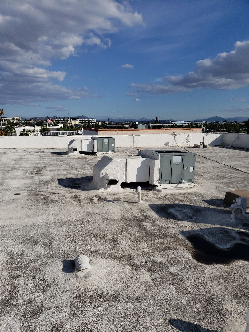 Kearney Mesa working on Amana heat pump systems.