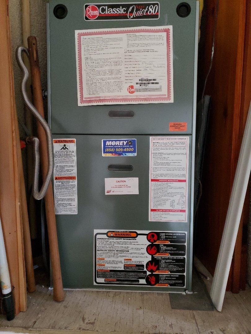 Rebuilding an ignition system on a Rheem gas furnace in Rancho Bernardo.