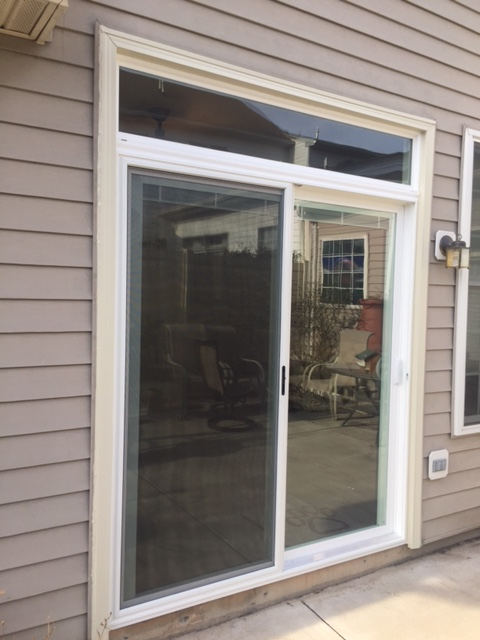 Ashburn, VA - Drafty, old, air leaking doors? Sun beating in on you, your carpet or drapes? Problem solved with this new 6ft. vinyl sliding patio door with internal blinds and a transom window. Energy efficient and protection from the sun thanks to Low E, Argon Gas, easy opening and more!