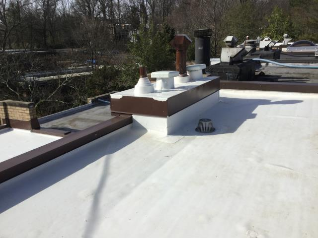 Reston, VA - No more ponding water or leaking with this new TPO Flat Roof Replacement- now has tapered/sloped insulation to divert water to drains and a long term  worry free warranty