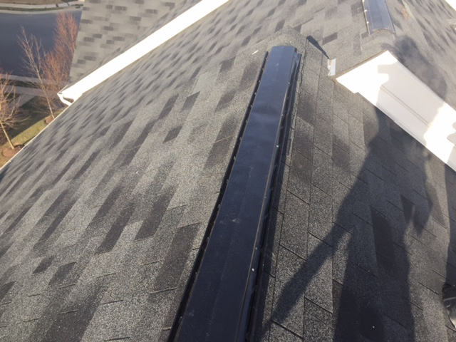 Ashburn, VA - Inspected aluminum ridge vent that was loose and leaking. Replaced the ridge vent, fastened and sealed!