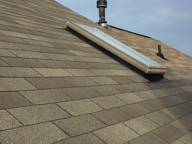 Sterling, VA - Townhouse Roof Replacement with GAF Sovereign Weathered Gray and a new skylight flashing