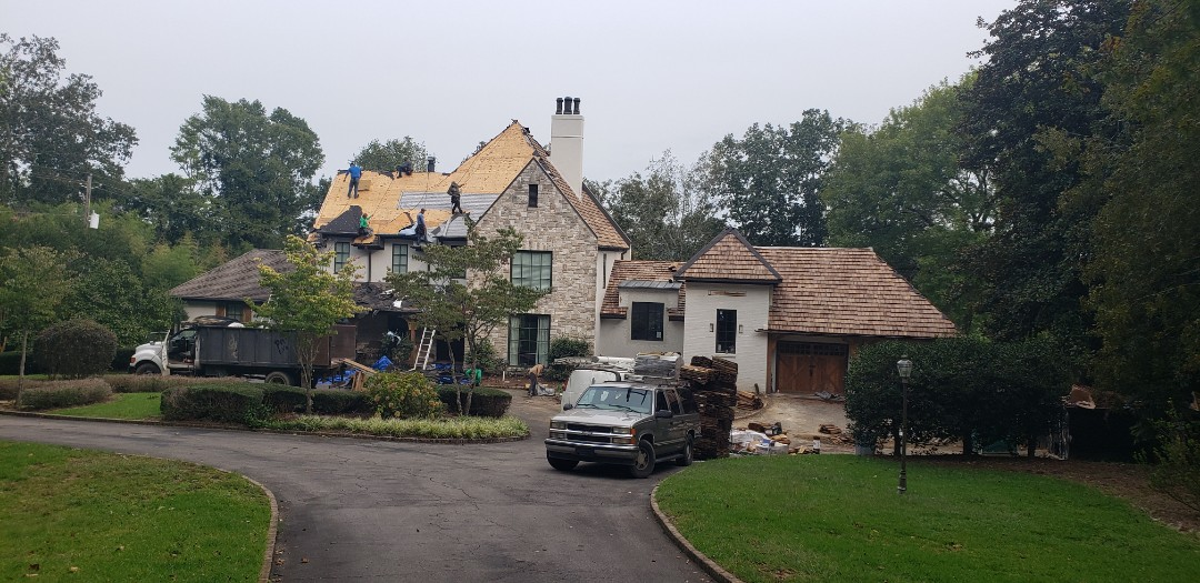 Birmingham, AL - Tearing off an old CertainTeed Independence shingle and replacing with a heavy cedar shake on this luxury estate in Mountain Brook