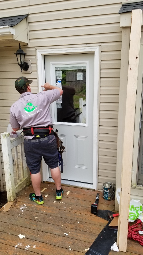 Fletcher, NC - Installing a new right hand in-swing door. Independent Construction Services is a GAF Master Elite roofing contractor with all appropriate licenses and insurance to take care of your roofing, siding, guttering and painting (exterior and interior) needs. Centrally� located� in� Mills River,� NC,� we are able to service both the greater Asheville and Hendersonville areas. Call us today at (828) 808-8482