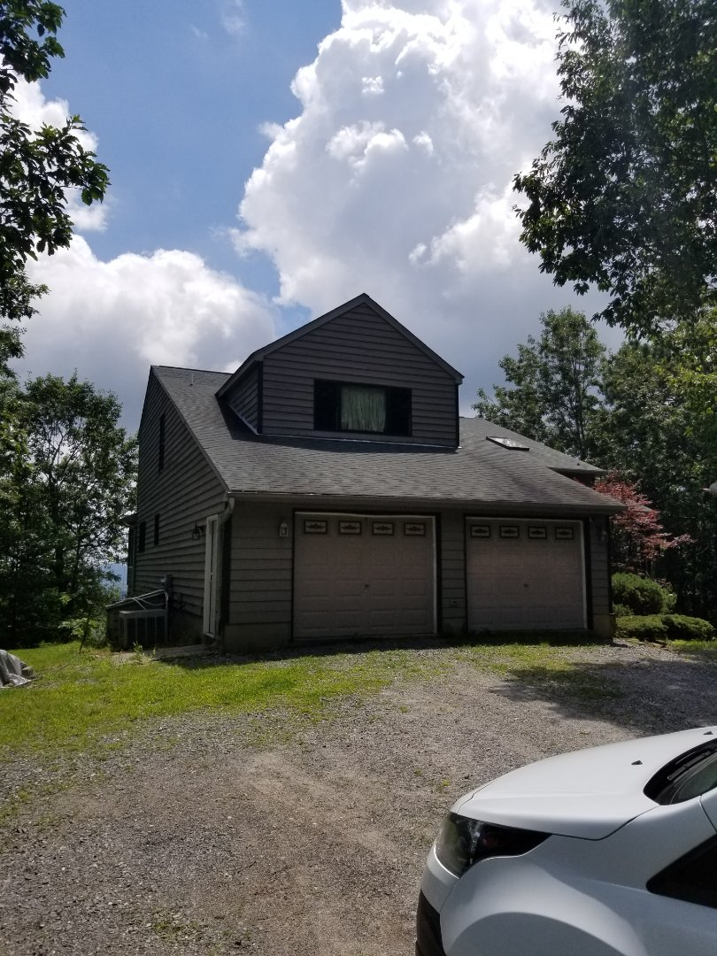 Black Mountain, NC - GAF Master Elite Roofer from Independent Construction Services performing Golden Pledge Roof Replacement Estimate. Trades include but are not limited to: roofing, gutters, and siding.