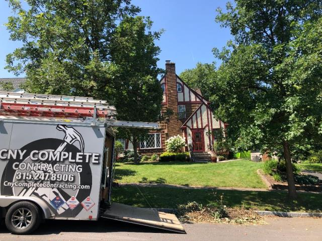 Syracuse, NY - Complete GAF System plus roof replacement Timberline HDZ Shingles in Hickory with GAF Intake pro