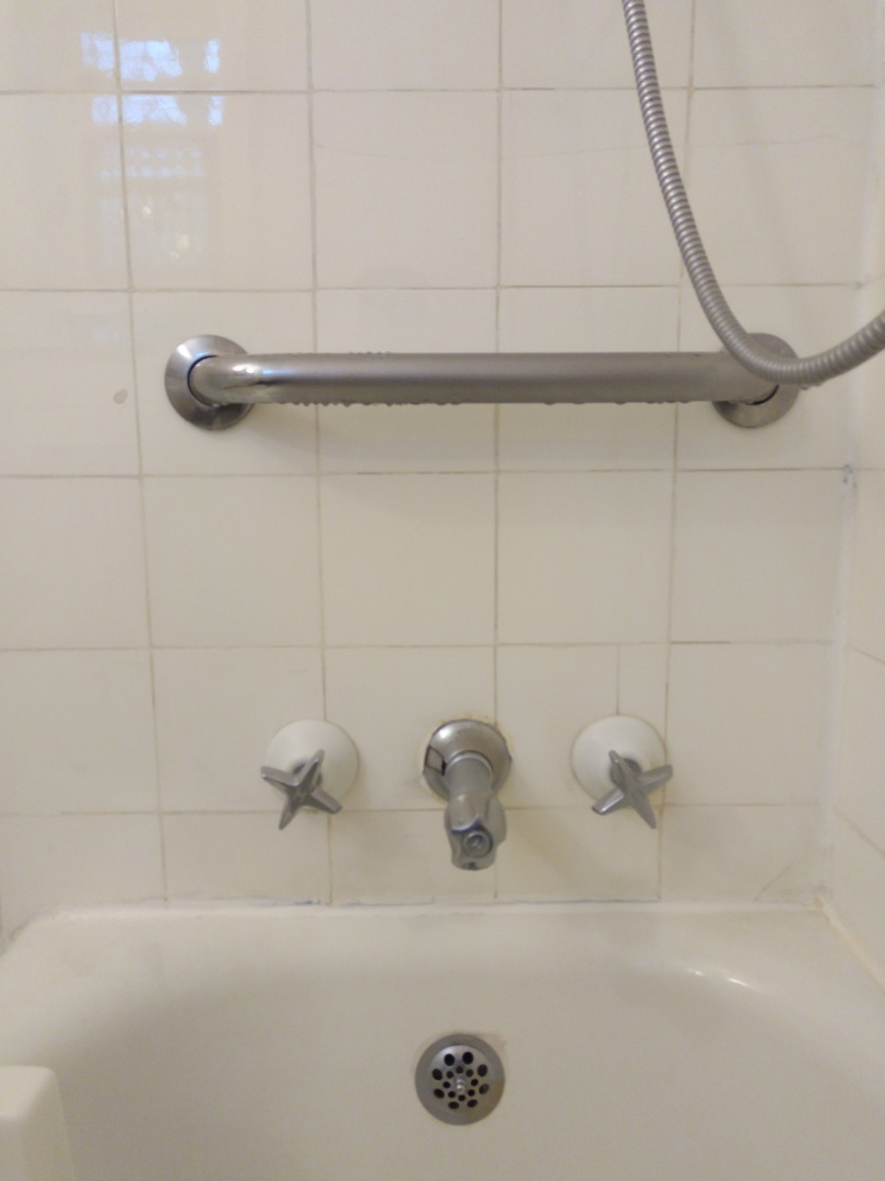 Replace old drippy tub and shower valve
