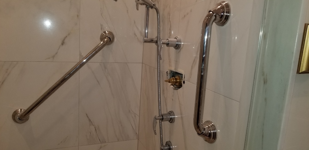 Installed grab bars and replace shower cartridge