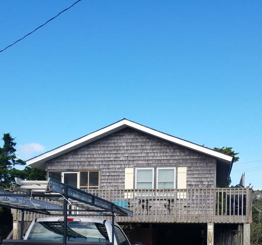 Avon, NC - This OBX beach box in Avon has recently received a new roof. The GAF Timberline HDZ with a cool color of Charcoal was installed by the roofing company serving the Outer Banks since 1952