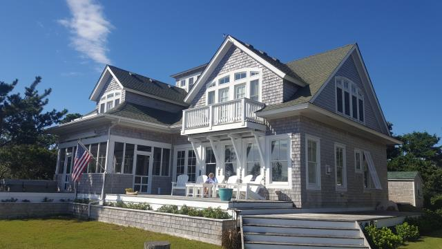 Ocracoke, NC - This gorgeous home will now be safe and secure for some time under a new fortified roof installed using Owens Corning Duration Tru Def Chateau Green architectural shingles!
