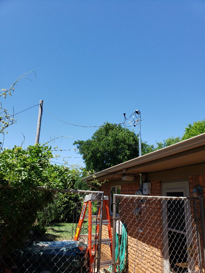 Midwest City, OK - Electric panel and service replacement after storm damage. Our licensed electrician is replacing the weather head, service riser, meter base and the electric panel to bring it up to current electric code.