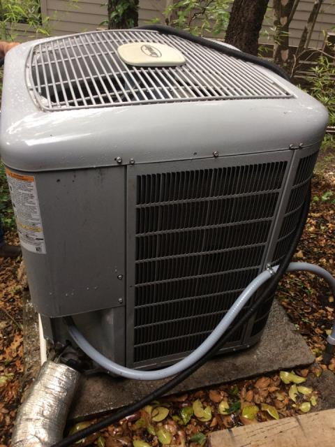 hvac contractors Bastrop. There is a clog in water removal system. Clear drain and put union on the lines. Check pressures and clean outside coils. System is operating at manufacture specifications at this time.