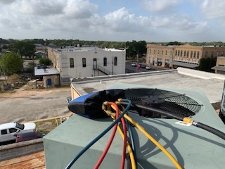Bastrop, TX - Commerical ac repair Bastrop. System has a leak. One of the drain pipes has come loose. Glu the pipe and stabilize it with proper pitch. System is no longer leaking.