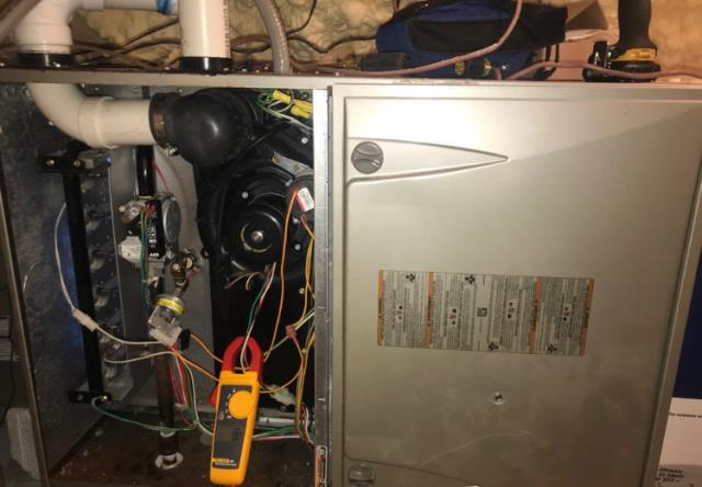Elgin, TX - Furnace repair Elgin. Test all incoming voltage to the outdoor aoc board and the board is bad. Replace part. System heating.