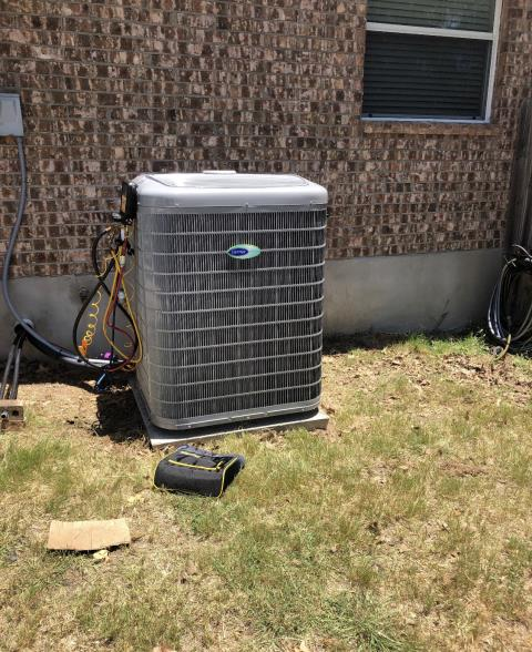 Cedar Creek, TX - Air conditioning. Perform cooling check on Carrier Green Speed ac system. The air conditioner is cooling properly at this time.
