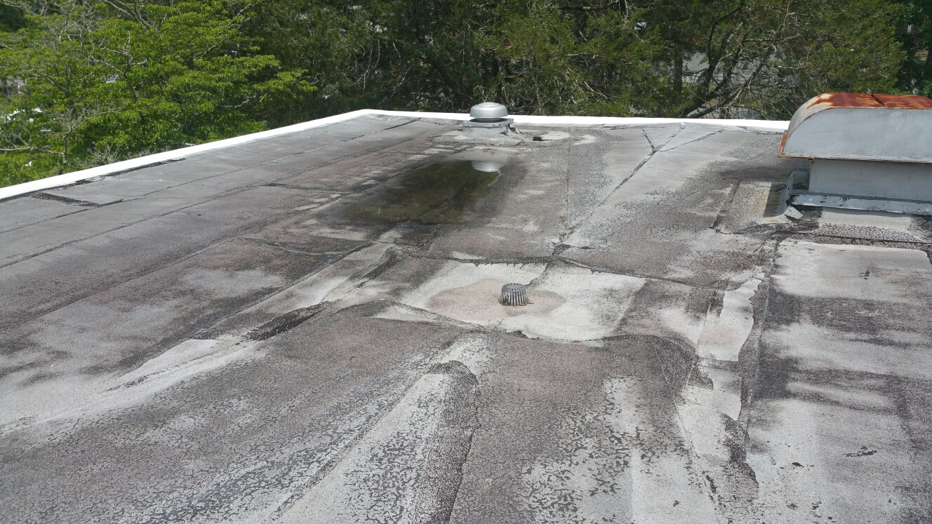 Hinesville, GA - Flat roof inspection and estimate in Hinesville ga by local roofing company jcb roofing