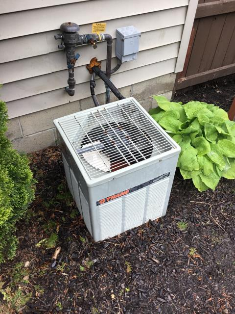 Westerville, OH - Let 2000 Trane unit run for 15 minutes, pressures held. Checked furnace one more time, found unit leaking from drain pan. Pulled door off and condensation immediately poured into drain line. Took shop vac and cleaned out a good amount of rust and debris. Evap coils are highly corroded and rust is flaking off, causing lines to plug.