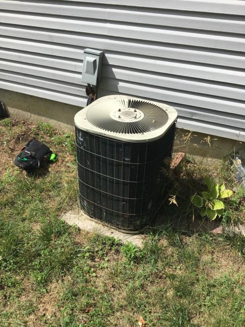 Columbus, OH - Found AC breaker tripped, reset. Coils on unit are damaged in areas, restricting air flow. This Bryant Unit is from 1987, but is currently cooling. Customer understands that with a unit this old, there is no guarantee on how long it will hold up. As a company, we do not suggest putting any money in to repairing system.