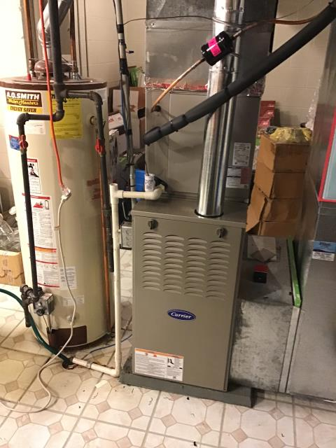 Groveport, OH - I removed part of the flue pipe to the Carrier 80% 70,000 BTU Gas Furnace and found debris that was restricting the flow of the exhaust and not allowing the furnace to vent properly. Removed debris and CO levels dropped to an acceptable level.
